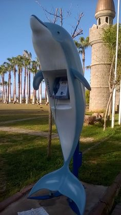 These are the phones on the beach in Mersin. The reason they are shaped like dolphins is that they are by the Mediterranean Sea. However, there is no real reason for them to be shaped like anything other than telephone booths, so they are art.