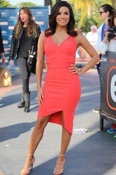 Latina stunner Eva Longoria visited the set of Extra sporting a $298Three Floor Coral Crepe Asymmetric Hem Zip Detail Mesh Insert Dress and $595 Tamara Me