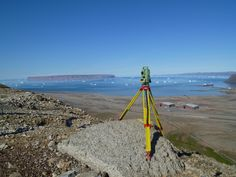 Surveyors Instrument and tripod. Taken overlooking Thule Air force base in Thule Greenland.