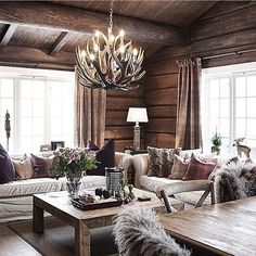 I absolutely love this living room so much! The color and that cool and fancy chandelier. Just wow!