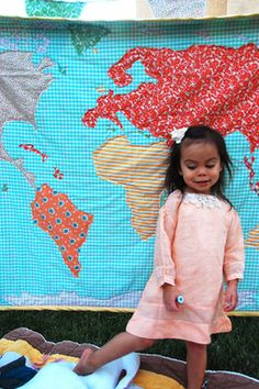 a world map quilt!  This is too cool!! *Beyond the basic idea, you could do so much with this!  Use fabrics that represent a country, embroider names of cities one has traveled to, applique fish and sea monsters... what a cool idea!* I don