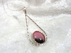 10x8 Rhodonite Pendant Twisted wire 925 Sterling Silver
