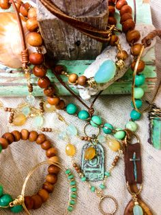 lovely mix of wood and aqua. I also like the stitched leather strap idea. | Johnny Loves June - Handmade Jewelry