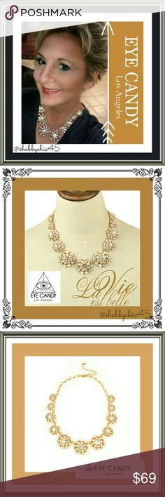 Eye Candy LA  Crystal Flower Collar Necklace Absolutely stunning collar necklace made with round cut crystals set in 18k burnt yellow gold plated brass. So versatile. Dress up a casual V-neck T-shirt or class up a night on the town outfit. It is beautiful and the crystals sparkle catching the light and turning heads!  ??Smoke free home. No trades. Open to reasonable offers unless marked as firm. Happy Poshing!!?? Eye Candy  Los Angeles  Jewelry Necklaces