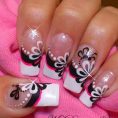 This video tutorial shows how to create nail art using nail stripers, rhinestones, and black, white, and pink nail polish colors. DIY this playful twist on the classic french tips today!