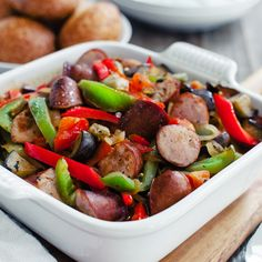 Greek-Style Sausage and Peppers - Spetzofai is a simple dish of sausage and peppers, simmered in a zesty tomato-based sauce. Your family will love it!