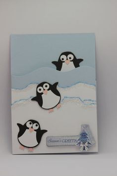 Handmade with love featuring 3 playful penguins made using the Stampin UP Owl Punch. On a winter blue cardstock base these 3 penguins are sure to