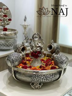 Naj Jewellery created Silver Roof like a temple Theyt tend to like antique things. Something can be old but it can be timeless.Available only @ NAJ Lord Ganesha sitting between the water. Call or WhatsApp @ Ethnic Home Decor, Indian Home Decor, Silver Home Accessories, Temple Design For Home, Diwali Decorations At Home, Silver Pooja Items, Pooja Room Door Design, Silver Lamp, Puja Room