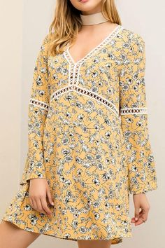 Pale yellow floral dress features bell long sleeves, v-neck, and lace trim detail. Wear alone or layer over leggings.   Floral Baby Doll Dress by Mio. Clothing - Dresses - Long Sleeve Clothing - Dresses - Mini Roanoke, Virginia