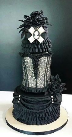 Steampunk cake with corset, ruffles and flowers in black and white tones