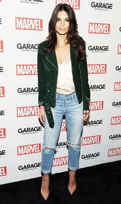 Emily Ratajkowski dresses up her favorite pair of distressed denim with a silk cami, suede moto jacket, and pointed toe pumps