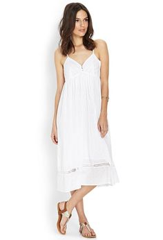 Love 21 - A woven cami dress featuring an embroidered dot pattern and lace accented yoke. Complet...
