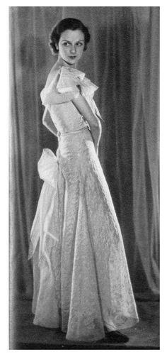 Chanel organdie evening dress, B '24979' Model '235', S/S 1933 triple-layered fichu-like collar with small bow centre-front, the upper layer of the collar & main body embroidered overall w/ stylised leaves, the gored, flared skirt embroidered to shape w/ undulating embroidered hem, the back w/ criss-cross lacing, culminating in a butterfly bow, w/ matching silk satin slip w/ scalloped hem. One of the most popular models from the S/S 1933 collection. Images appeared in magazines in EU & the… Satin Slip, Silk Satin, Chanel Couture, Victoria S, John Galliano, Scalloped Hem, Vintage Chanel, Flare Skirt, Passion For Fashion