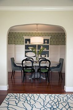 I really like the imperial trellis wallpaper above the board and batten, and the back of the hutch painted a contrasting color, and the drum shade.