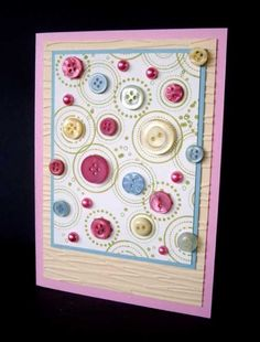 Use paper printed with circles, or attach buttons then draw circles around each