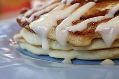 Cinnamon Roll Pancakes - shown with drizzled cream cheese