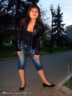 Three quarter pants. Street fashion in Moscow. Random photos. Black women's short leather jacket.