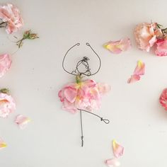 Playing with the things I like most: my wire dolls and beautiful flowers
