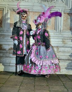 With elaborate costumes of pinks grays and black and covered in roses this pair was ready for Carnival of Venice 2015~ Nemodus photos ~ Flickr - Photo Sharing!