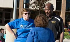 Dean Matthew Adeyanju talks with faculty and staff during Fall 2013 at an event.