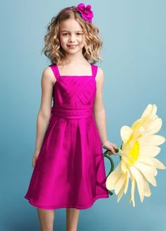 Ultra feminine and super sweet, this is the perfect dress for your junior bridesmaid on your special day!  Sleeveless bodice features pleated detail that shapes a stunning silhouette.  Ruched banded empire waist is flattering and chic.  Beautiful organza fabric is stunning and airy.  Fully lined. Back zip. Imported polyester. Dry clean.  Select colors are on sale. Please select color and size to view pricing.  Sizes and colors are available in limited stores and with limited availability.