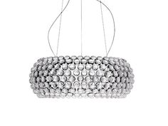 The Foscarini Caboche Suspension Light is made up of transparent jewel-like spheres. It provides a soft, diffused light.
