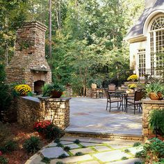 Fireplace Patio      Entending directly out from the house, this patio is visible from inside the house through large arched windows. Beautiful dining furniture is arranged in separate sitting and eating areas and surrounded by a pretty stone wall all around
