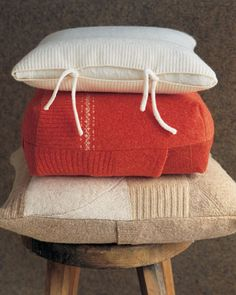 A trio of pillowcases incorporates sweater bodies, sleeves, and waistbands. Before you begin, learn how to felt a sweater.Customize one that works with the design of your felted sweaters.The white cover consists of a cashmere sweater's body that is sewn on one end; add ties (3/4-inch strips, rolled and whipstitched) to other end. To conceal pillow inside, fold another piece of the fabric over its edge and stitch one end to cover. The envelope-style orange cover (with darts at corner...