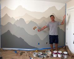 Project Nursery: Mountain Mural by John with shades of grey and tan is a woodland nursery