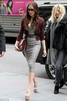 Love this style Victoria Beckham is wearing! The single belt is now the double belt.