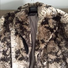 Topshop faux fur snake print coat Gorgeous snake print pattern in brown and cream faux fur. This coat looks great and is warm too! Only worn once for a couple of hours, it is in beautiful condition with no damage at all. Hidden snap button closure and side pockets. Purchased from Nordstrom in 2015. Topshop Jackets & Coats