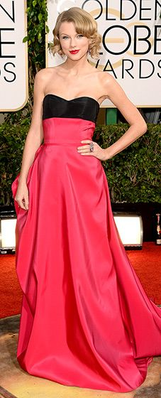 Taylor Swift: 2014 Golden Globes The country pop superstar wore a strapless gown by Carolina Herrera with a black bustier and plum-colored skirt with an elaborate train. She paired her look with Lorraine Schwartz jewels, Louboutin shoes and a clutch by Jimmy Choo.
