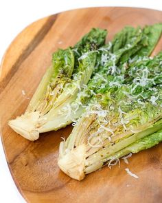 Grilled romaine lettuce.  Gotta be one the strangest sounding things, but it is DELICIOUS!  Just rub the cut side of a washed head of romaine with some olive oil, and place it cut side down on the grill.  As soon as the grill marks appear (and the lettuce just begins to wilt), remove it,  put it on the plate (cut side up) and dress with some shaved parmesan cheese.