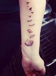 Book pages becoming Birds Tattoo. Books make you immortal. And this amazing book tattoo design is the best depiction of what's said right.