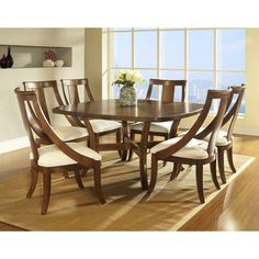 @Overstock - Somerton Dwelling Gatsby 7-piece Dining Set - This collection, featuring a rich brown finish and figured walnut veneers, creates an inviting style for any contemporary interior. Composed of hardwood solids and veneers, the set includes a dining table and six side chairs in a warm medium brown.  http://www.overstock.com/Home-Garden/Somerton-Dwelling-Gatsby-7-piece-Dining-Set/8101180/product.html?CID=214117 $1,847.06