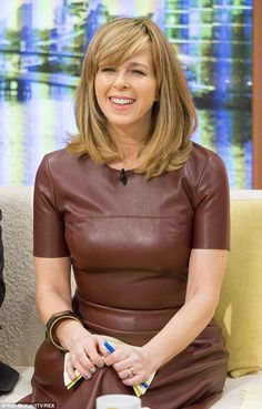 C'est chic: Kate Garraway wears a sophisticated brown leather dress on Good Morning Britai...