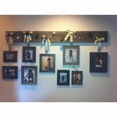 Old board with antique door knobs used to hang pictures.