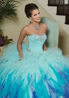 """""""Let it go"""" in this amazing, fabulous, and fun dress from Vizcaya by Mori Lee! Beautiful strapless sweetheart gown with crystals and beads on the corseted bodice. This particular color called """"Twilight"""" would be perfect for an """"Under the Sea"""" or """"Frozen"""" theme!"""