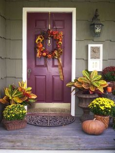 Aside from the vases, planters and pumpkins you can also hang a fall wreath on the door