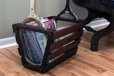 magazine rack from old tennis rackets