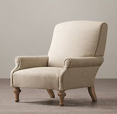 RH's English Upholstered Club Chair:The comfortable seating that furnished gentlemen's clubs in 19th­-century London – and no doubt was responsible for their popularity – inspired our English Club Chair. Styled with a dramatic rake, it features elongated arms and boldly turned front legs.