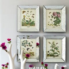 http://www.grahamandgreen.co.uk/mirrored-butterfly-print-picture-frames Adore these tarnished mirrored frames. They look great with the existing prints, though I'd love to see them with personal black and white photos...