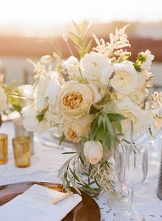 Reception | nice mix of mercury glass candle votives. I love the flowers too, comments of this stated in other similar pin