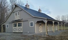 This 36' x 48' High Country horse barn, proudly manufactured by Appalachian Woodcrafts, has 8' lean to overhangs on both sides of the barn to protect your horses and equipment. This barn is located in Johnstown, PA and was built with American grown eastern white pine rustic board and batten siding. The barn is painted in Haley Paint's, clay color with tan trim. The 8 pitch roof and overhangs have black metal roofing made by Everlast Metal.