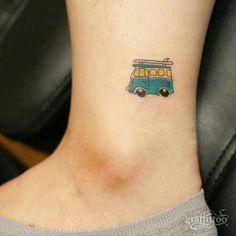 Tiny surfer van ankle tattoo