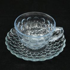 Sapphire Blue Bubble pattern was produced by the Fire King division of Anchor Hocking beginning in This pretty glassware was advertised as being Heat Proof and was one of the first glass patterns that could go from freezer to oven. Vintage Dishes, Vintage Glassware, Vintage Pottery, Vintage Antiques, Dinner Ware, Anchor Hocking, Cup And Saucer Set, Glass Collection, Tea Sets