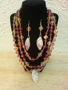 3 strand necklace with leaf dangle earrings.