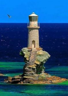 The lighthouse Tourlitis of Andros Island, Greece, was bulit in bombarded during the World War II, and later restored in Beautiful Buildings, Beautiful Places, Lighthouse Pictures, Beacon Of Light, Fantasy Places, Am Meer, Scenery, Ocean, Island