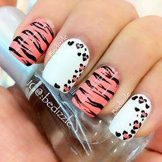 Zebra and leopard print nails. I love how the leopard spots look like hearts!! Gorgeous design.
