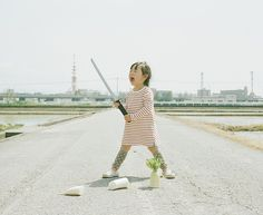 Creative Dad Takes Adorable Portraits of Daughter.  Photograph by Nagano Toyokazu